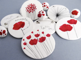 Lamai Brooch -- collection of red ad white brooches